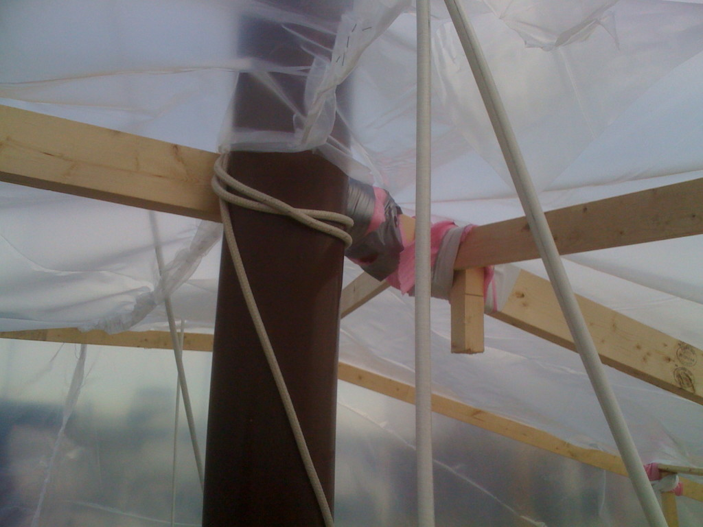 Plastic cut around the mast and rewelded