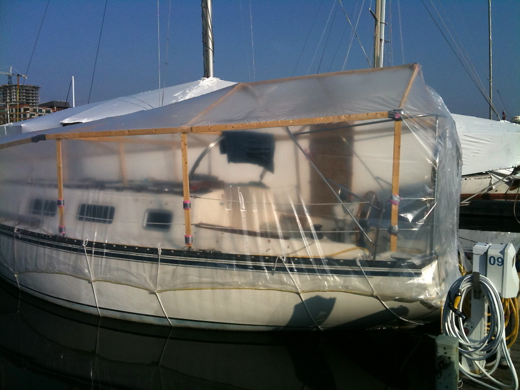 Shrink wrapped sailboat in the water